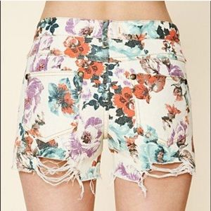 Free people Distressed denim white floral shorts